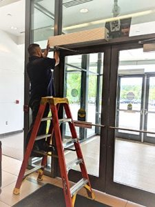 Automatic Door Services employee providing expert maintenance on an automatic door