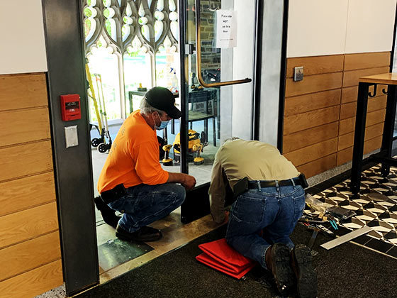 commercial door installation by 2 service people of Advanced Door Service