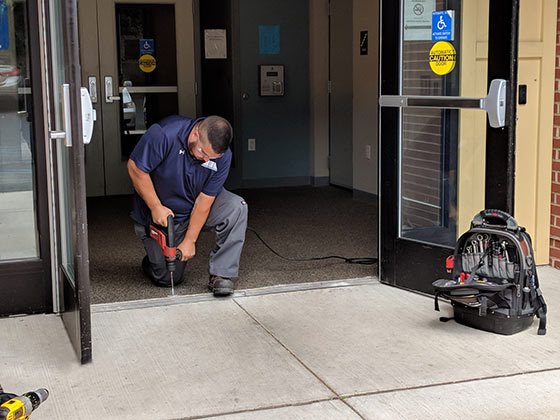 commercial door repair being done by Advanced Door Service